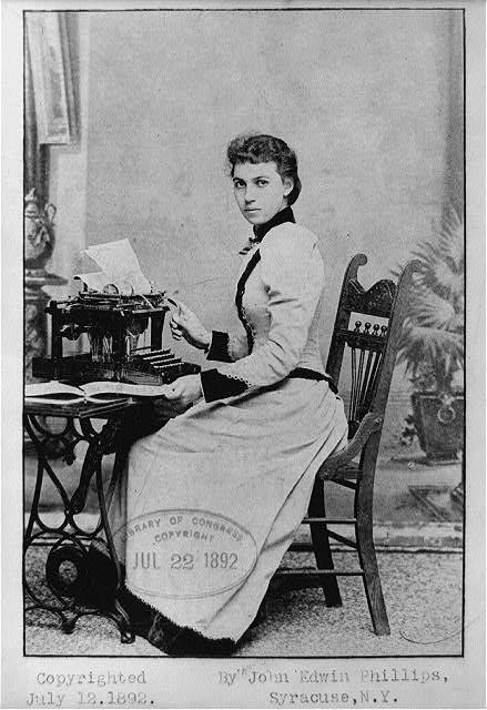 Young woman sitting at desk with typewriter, c. 1892.